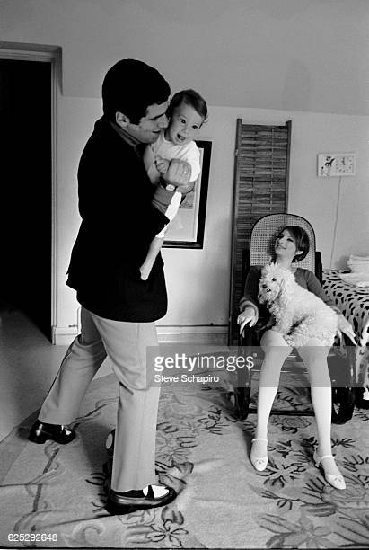 Married Americans actor Elliott Gould and actress musician Barbra Streisand play with their son Jason and dog in their home Beverly Hills California...