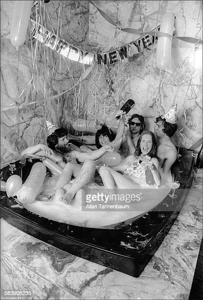 Married art dealers Louis and Susan Meisel host a New Years' Eve party in their oversize bathtub New York New York December 31 1974