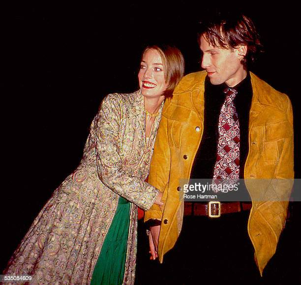 Married British couple model Lucie de la Falaise and graphic artist Marlon Richards attend the Yves Ste Laurent 'Champagne' perfume launch on Liberty...