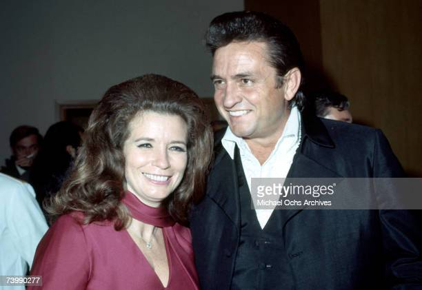 Married country singers Johnny Cash June Carter Cash attend an event in September 1969