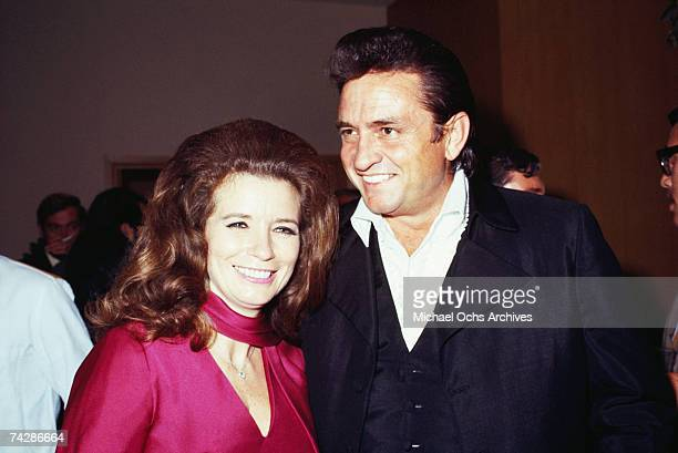 Married country singers Johnny Cash June Carter Cash pose for a portrait at an event in September 1969 in California