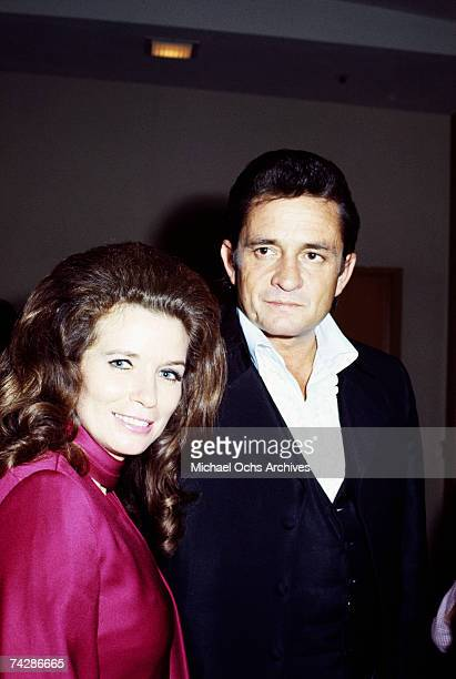 Married country singers Johnny Cash & June Carter Cash pose for a portrait at an event in September 1969 in California.