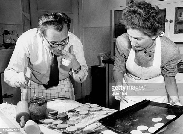 Married couple baking biscuits together about 1949