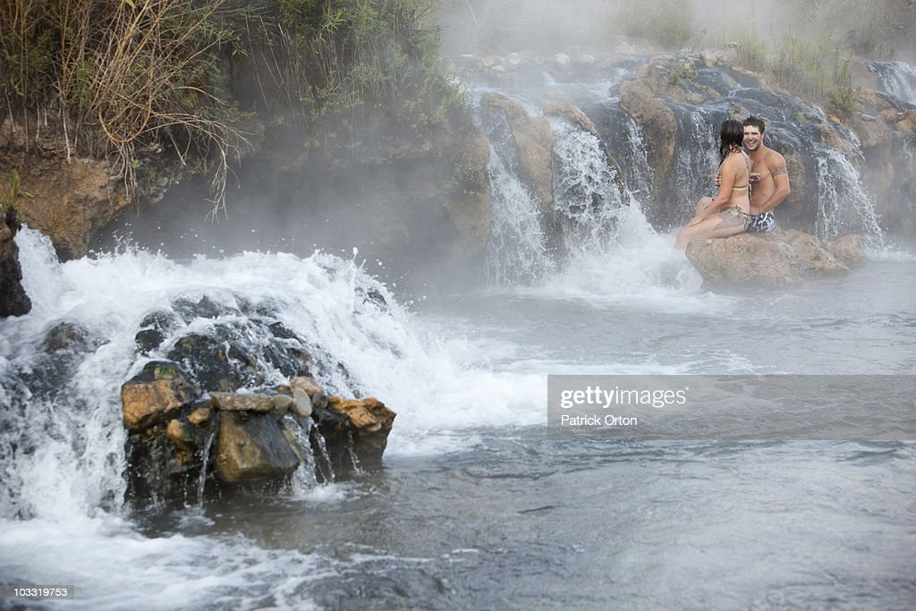 A married couple enjoys natural hot springs in Montana. : Stock Photo