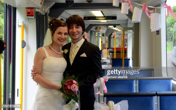 Married couple Evamaria and Takashi Yoshida kiss in front of a street car in Duesseldorf Germany 01 June 2013 They met in June 2008 in the street car...
