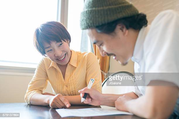 Married couple filling out paperwork together
