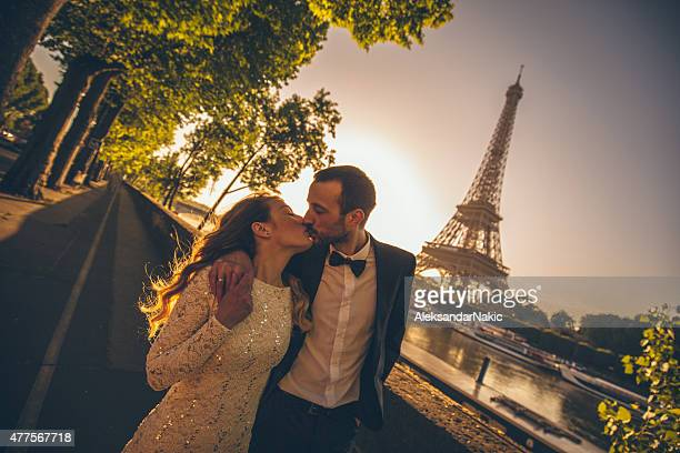 Married couple kissing by the river