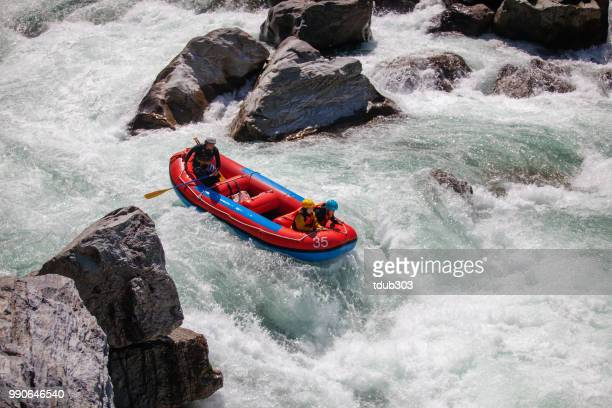 Married couple on a guided white water river rafting tour