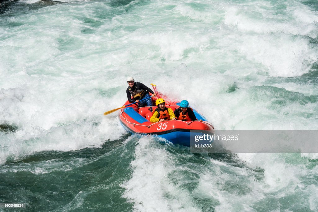 Married couple on a guided white water river rafting tour : Stock Photo