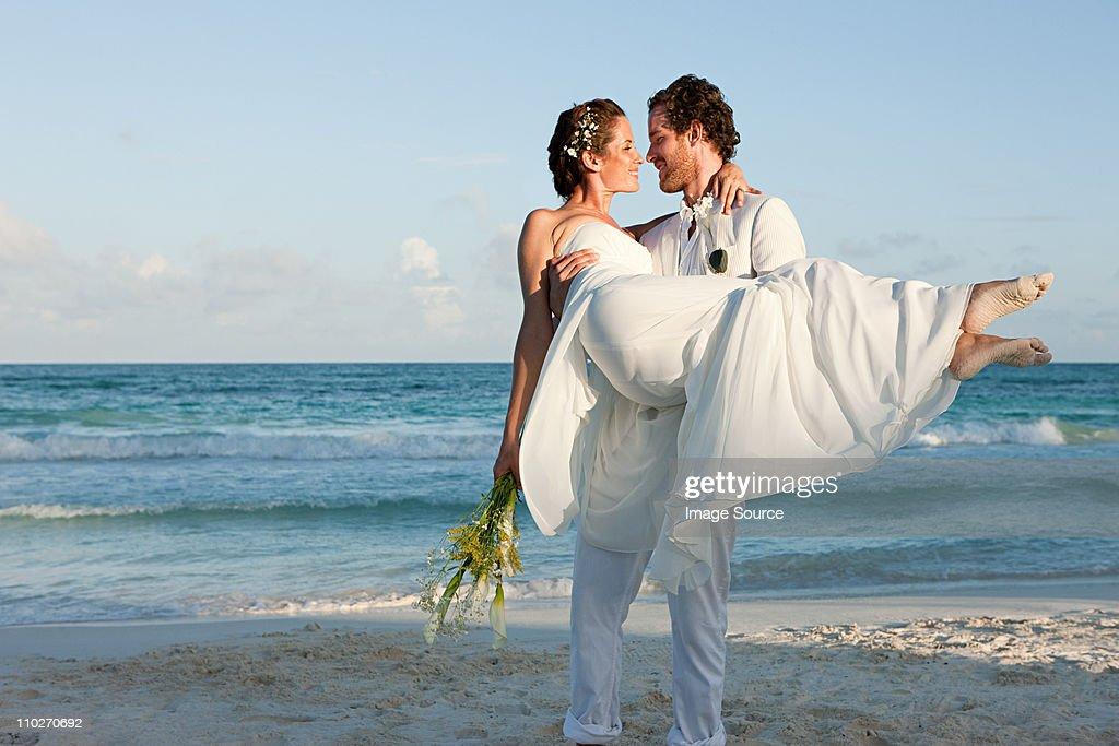 Married couple on beach : Stock Photo