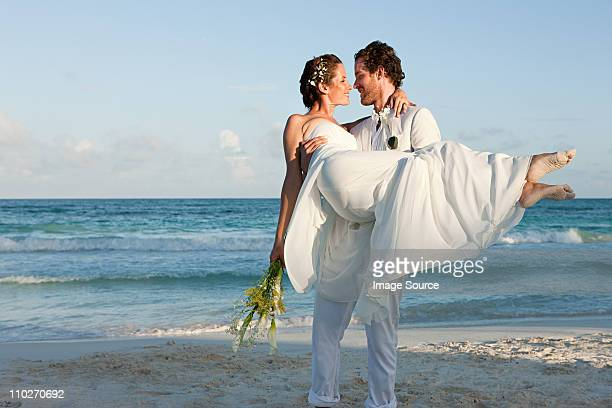 married couple on beach - wedding stock pictures, royalty-free photos & images