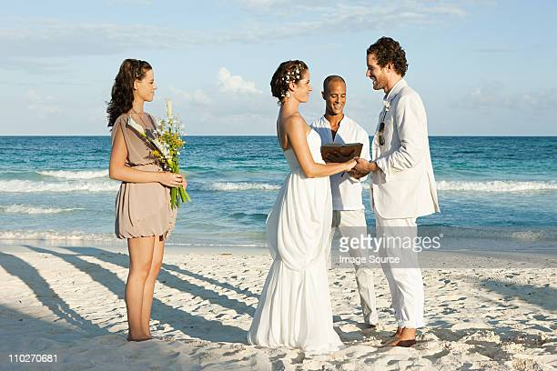 Married couple on beach with friends