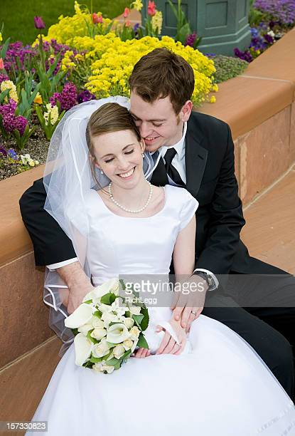 married couple on bench - rich_legg stock photos and pictures