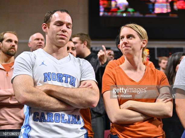 Married couple Phil Handler and Meredith Trubitt of Washington D.C. Attend a game between the North Carolina Tar Heels and the Texas Longhorns during...