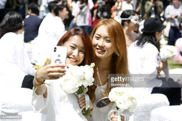 Married couple poses for a selfie photograph during a pro same-sex marriage party organized by the Taipei City government and Marriage Equality...