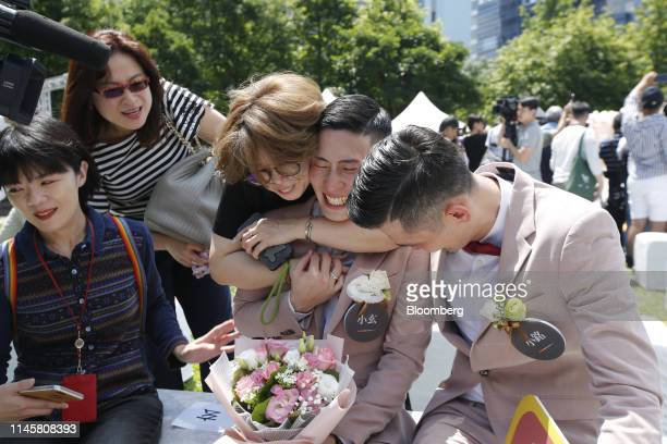 Married couple reacts during a pro same-sex marriage party organized by the Taipei City government and Marriage Equality Coalition Taiwan in Taipei,...