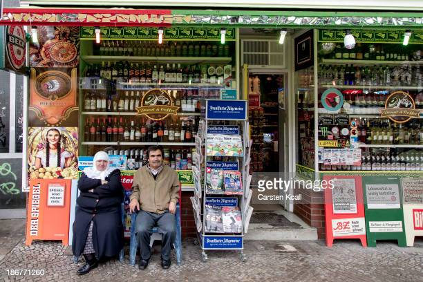 Married couple Sebahattin and Sefalt Hisarci sit on chairs in front of a shop at KarlMarxPlatz in Neukoelln district on November 02 2013 in Berlin...