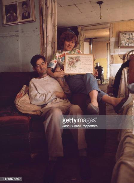 A married couple showing their marriage certificate at their home Pike County Kentucky US 1967