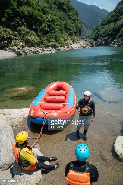 Married couple training to go on a white water river rafting tour