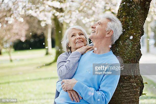 Married couple underneath cherry tree, Baden-Wurttemberg, Germany