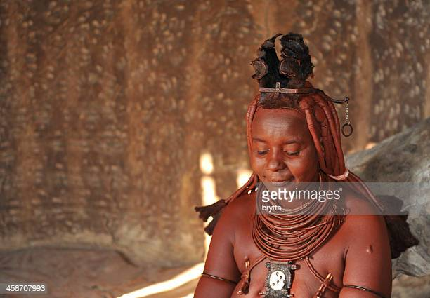 married himba woman inside hut in village near opuwo,namibia - opuwo tribe stock photos and pictures