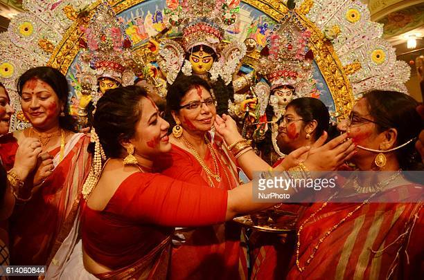 Married Hindu women apply vermillion on one another's face as a part of the rituals on the last day of Durga puja in Kolkata India on Tuesday 11th...