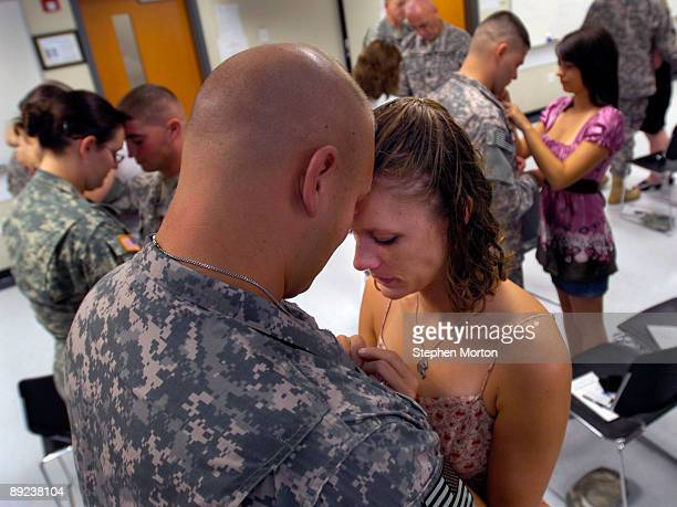 Married just over a month, Amy Cosens and her husband U.S. Army PFC Lee Cosens exchange half of a pewter coin during the 3rd Infantry Division's...