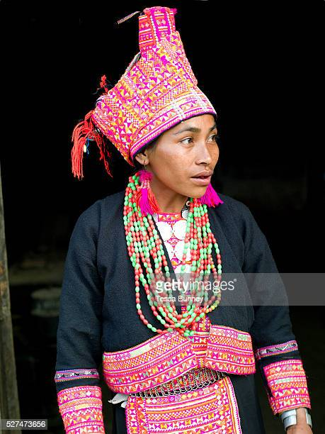 A married Ko Pala ethnic minority woman wears her traditional costume at home Ban Honglerk Phongsaly Province Lao PDR The brightly coloured...