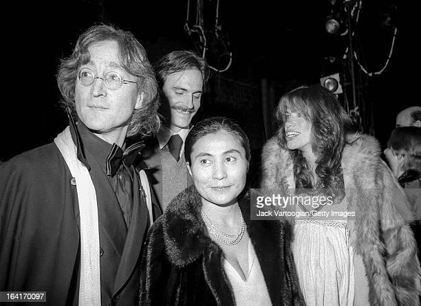 Married musicians John Lennon and Yoko Ono along similarly married musicians James Taylor and Carly Simon attend the opening night of the Merce...
