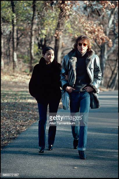 Married musicians John Lennon and Yoko Ono walk in Central Park New York New York November 26 1980 They were in the park to film a video for the song...
