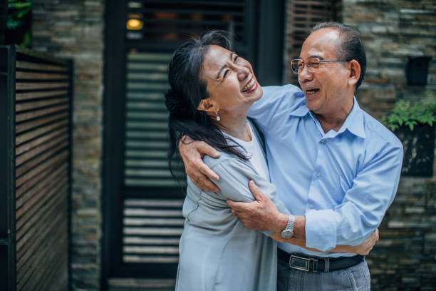 married senior couple hugging - asian old couple stock pictures, royalty-free photos & images