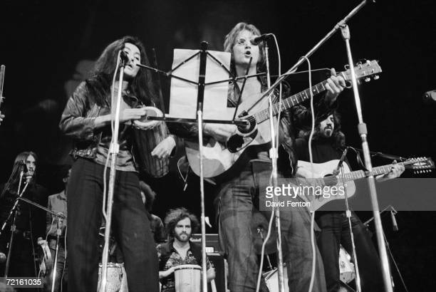 Married singer musicians Yoko Ono and John Lennon perform at the 'Free John Now' rally at Crisler Arena Ann Arbor Michigan December 10 1971 Political...