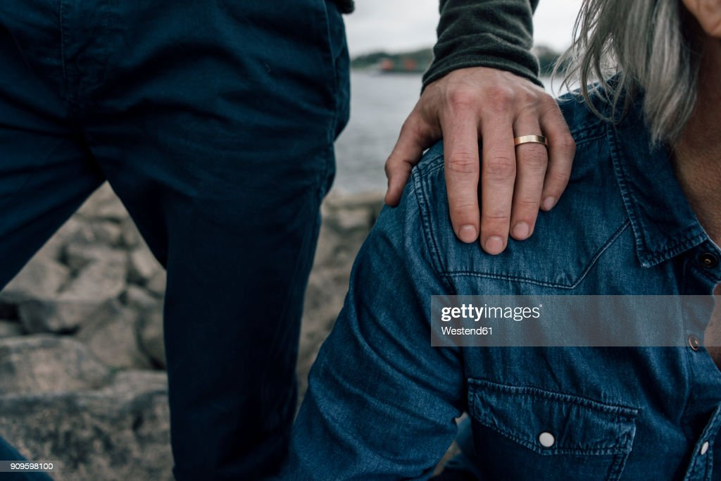 Married son putting hand on father's shoulder : Stock Photo