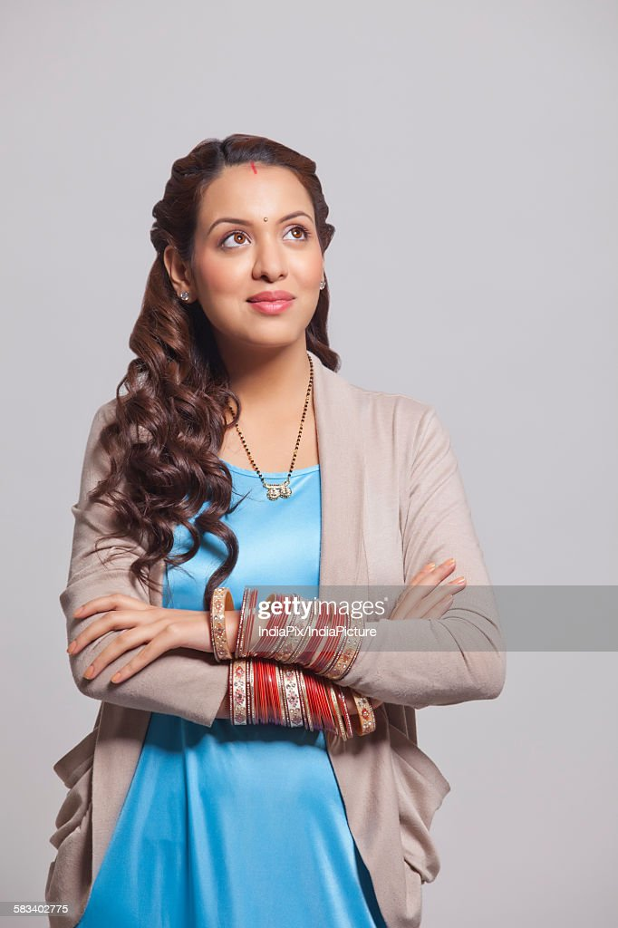 Married woman with bangles looking up : Stock Photo
