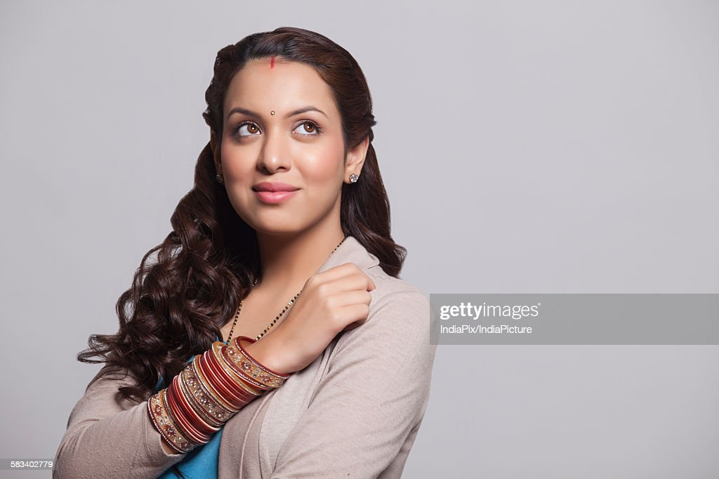 Married woman with bangles smiling : Stock Photo