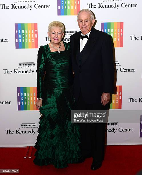 W Marriott and wife Donna Garff arrive at a special dinner for Kennedy Center honorees and guests at the State Department in Washington DC on...