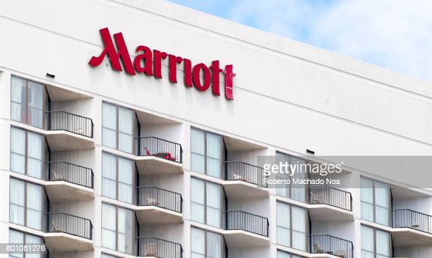 Marriott Hotel Sign or Logo Upper floors with railings in balconies in white building