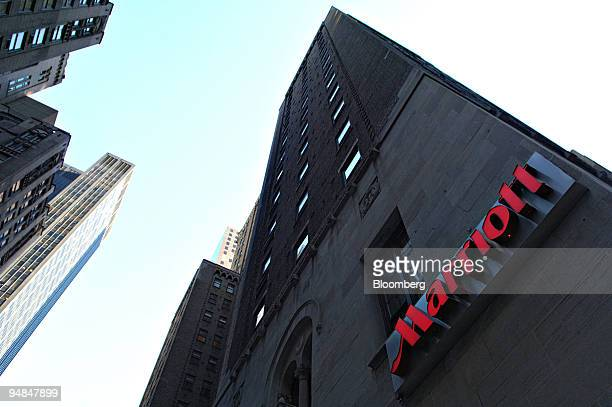 Marriott logo hangs on the side of a hotel in New York Thursday February 9 2006 Marriott International Inc the largest US hotel operator said...