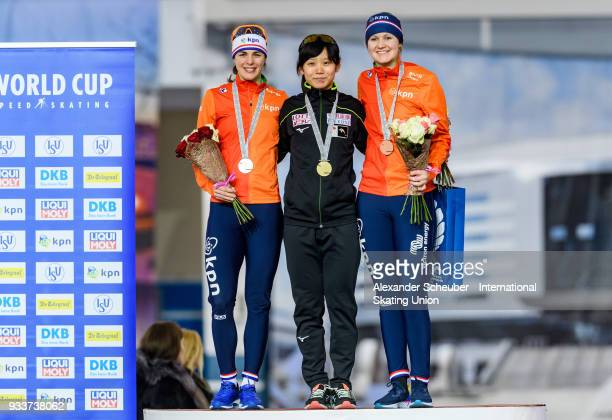 Marrit Leenstra of the Netherlands Miho Takagi of Japan and Lotte van Beek of the Netherlands stand on the podium after the Ladies 1500m Final during...