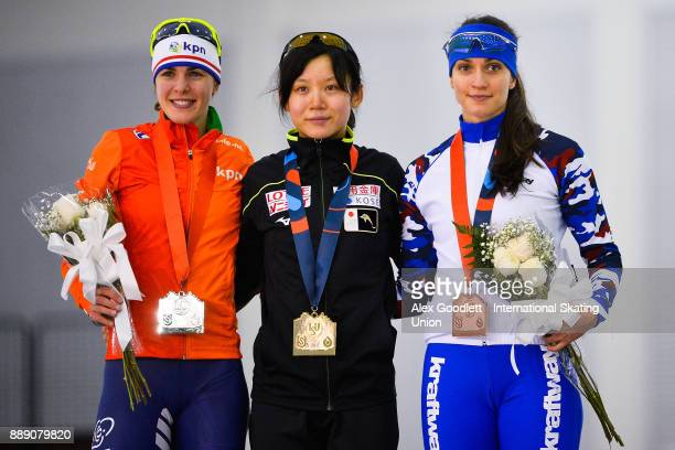 Marrit Leenstra of the Netherlands Miho Takagi of Japan and Yekaterina Shikhova of Russia stand on the podium after the ladies 1500 meter race during...