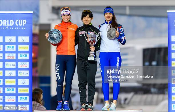 Marrit Leenstra of the Netherlands Miho Takagi of Japan and Yekaterina Shikhova of Russia stand on the podium after the Overall Classification of the...