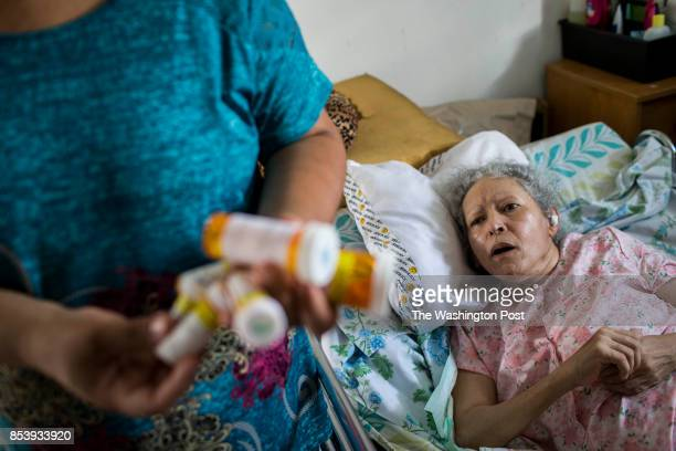 Marry Ann Aldea holds her mother Maria Dolores Hernandez medicines at her home Hernandez suffers from many health conditions that will be aggravated...