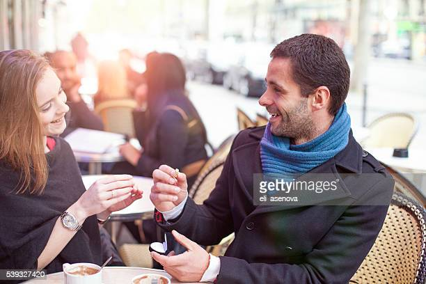 marry me, man proposing marriage in a cafe paris, france - man holding engagement ring stock photos and pictures