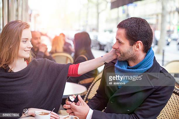 Marry me, man proposing marriage in a cafe Paris, France