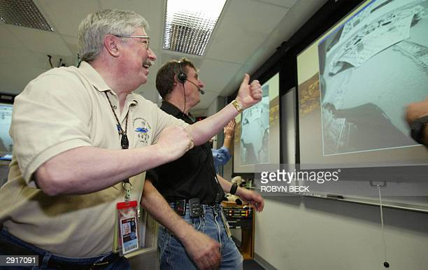 Mars Exploration Rover project manager Pete Theisinger reacts as images of the empty Opportunity rover lander arrive at Mission Control at NASA's Jet...