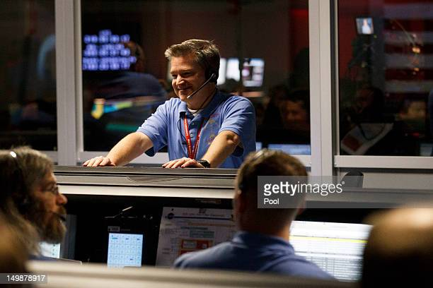 Mars Science Laboratory Flight Director Keith Comeaux smiles before the rovers landing, inside the Spaceflight Operations Facility for NASA's Mars...
