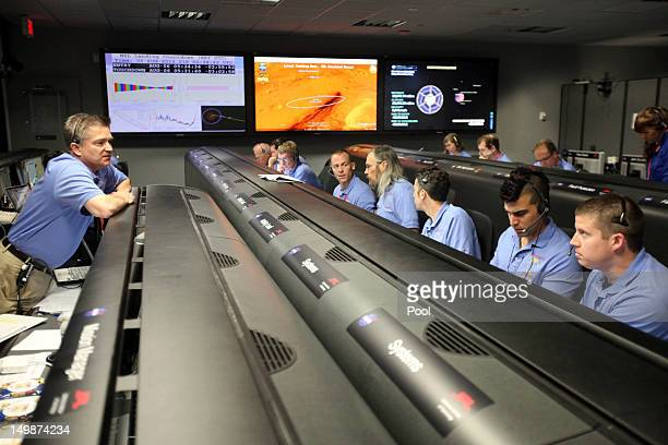 Mars Science Laboratory Flight Director Keith Comeaux , talks to his team inside the Spaceflight Operations Facility for NASA's Mars Science...