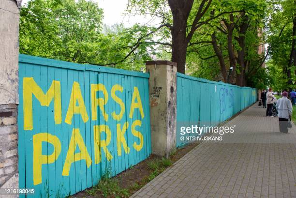 Marsa Park is painted on a wooden fence during a protest to save trees in Riga Latvia on May 28 2020 Around 400 protesters made a lastditch attempt...
