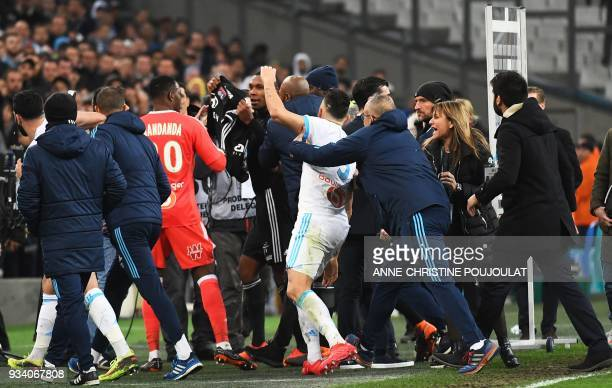 TOPSHOT Marseille and Lyon footballers argue at the end of the French L1 football match between Marseille and Lyon at The Velodrome Stadium in...