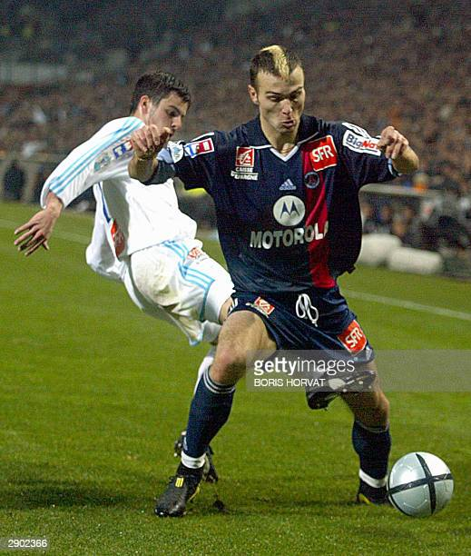 Marseille defender Fabio Celestini fights for the ball fights for the ball with Paris StGermain forward Danijel Ljuboja 24 January 2004 at the...
